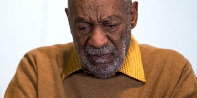 FILE - In this Nov. 6, 2014 file photo, entertainer Bill Cosby pauses during a news conference. Cosby...