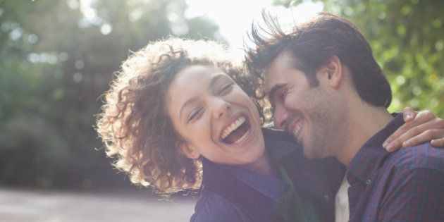 Close up laughing couple