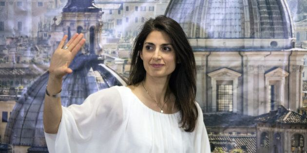 Virginia Raggi, Rome's mayor-elect, wavess during a news conference in Rome, Italy, on Monday, June 20,...