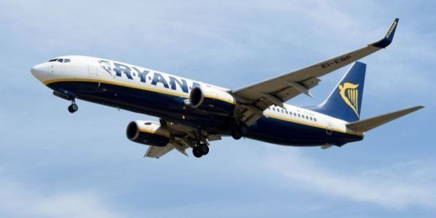 An airplane of the Irish low-cost airline Ryanair prepares to land at Barcelona's airport in El Prat...