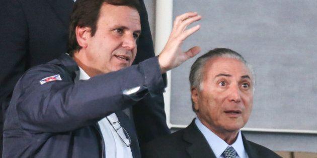 RIO DE JANEIRO, BRAZIL - JUNE 14: Rio de Janeiro's Mayor Eduardo Paes (L) speaks with Brazil's interim...
