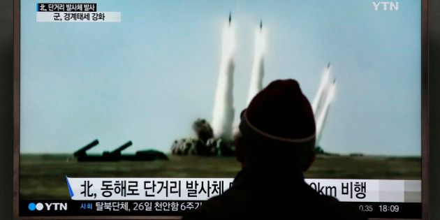 A man watches a TV screen showing a file footage of the missile launch conducted by North Korea, at Seoul...