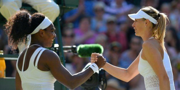 US player Serena Williams (L) shakes hands with Russia's Maria Sharapova (R) after Williams won their...