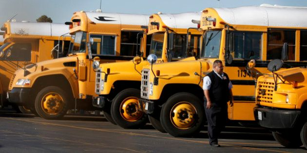 GARDENA ,CA., DECEMBER 15, 2015: LAUSD school buses are idle in the Gardena Garage after school district...