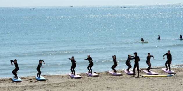 Enthusiasts learn to surf along the Songjeong beach in Busan on October 13, 2013. Songjeong beach stretches...