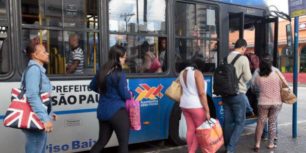 Passengers board a bus at the Santana bus terminal in Sao Paulo, Brazil, on Thursday, Jan. 21, 2016....