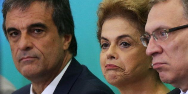 Brazil's President Dilma Rousseff (C), General Attorney Jose Eduardo Cardozo (L) and Justice Minister...
