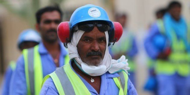 Foreign laborers working on the construction site of the al-Wakrah football stadium, one of the Qatar's...