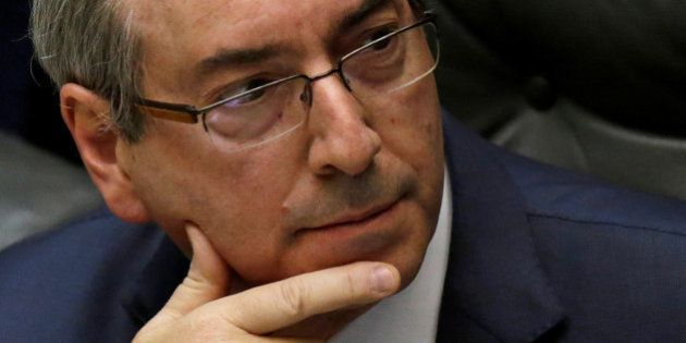 President of the Chamber of Deputies Eduardo Cunha reacts during a session to review the request for...