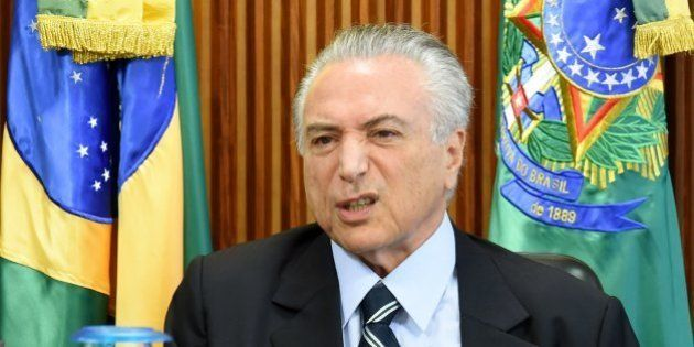 Brazilian acting President Michel Temer gestures during the first ministers meeting at the Planalto Palace...