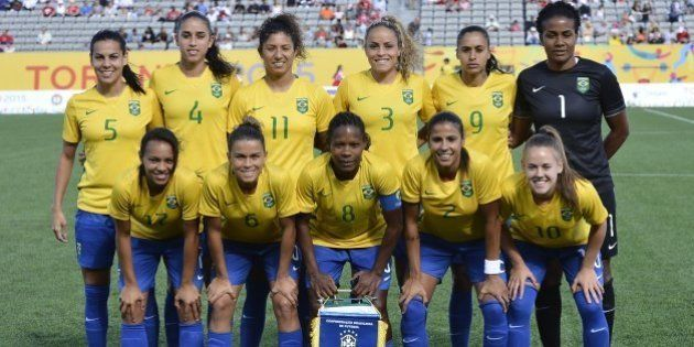 Brazilian football team pose for photographers before a semifinal match of the Pan American Games against...