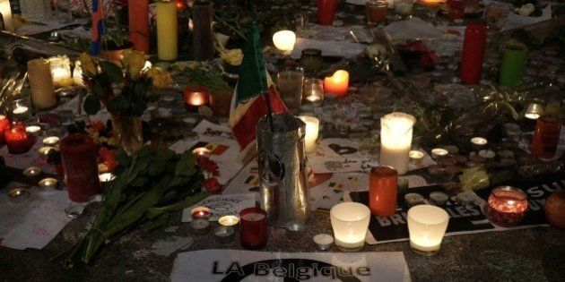 Candles are displayed in tribute to the Brussels attacks victims on March 24, 2016 on place de la Bourse...