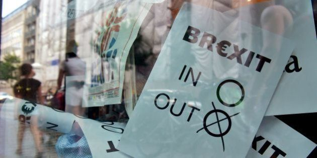 A poster featuring a Brexit vote ballot with 'out' tagged is on display at a book shop window in Berlin...