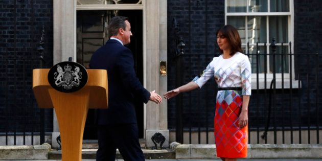 Britain's Prime Minister David Cameron his wife Samantha walk back into 10 Downing Street after he spoke...