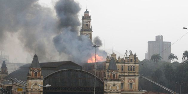 Long flames sprout up from the Museu da Lingua Portuguesa (Portuguese Language Museum) in Sao Paulo,...