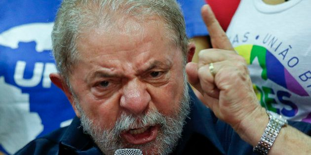 Brazil's former President Luiz Inacio Lula da Silva speaks during a press conference at the Workers Party...