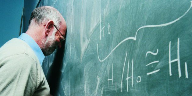 Portrait of a Frustrated Maths Lecturer Banging his Head Against a