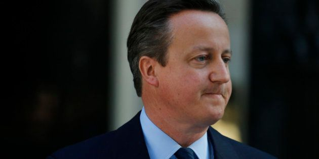 Britain's Prime Minister David Cameron turns away after speaking to the media in front of 10 Downing...