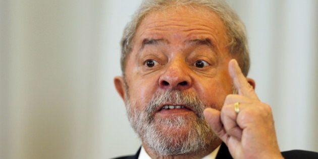 Former Brazilian President Luiz Inacio Lula da Silva speaks during a news conference with international...