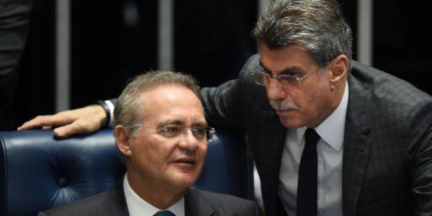 Senate President Renan Calheiros(L) and senator Romero Juca talk during debate Wednesday on suspending...