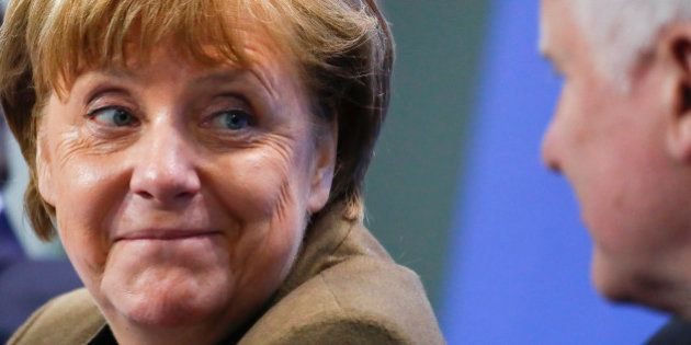 German Chancellor Angela Merkel smiles to Bavarian state premier and leader of the Christian Social Union...