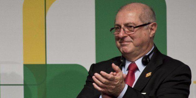 Brazilian President Dilma Rousseff (L) applauds next to Minister of Communications, Paulo Bernardo Silva...