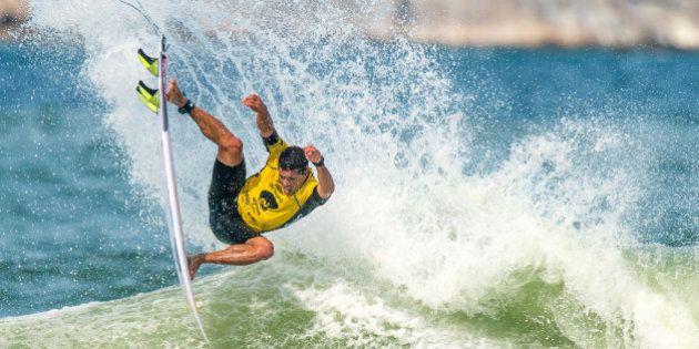 RIO DE JANEIRO, BRAZIL - MAY 15: Adriano de Souza of Brazil surfs during his Round 3 heat at the Oi Rio...