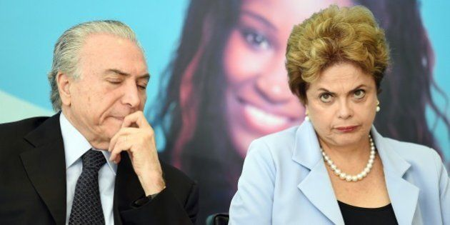 Brazilian President Dilma Rousseff (R) and Vice-President Michel Temer attend the launching ceremony...