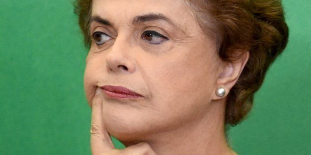 Brazilian President Dilma Rousseff gestures during a meeting with jurists and lawyers who provide support...