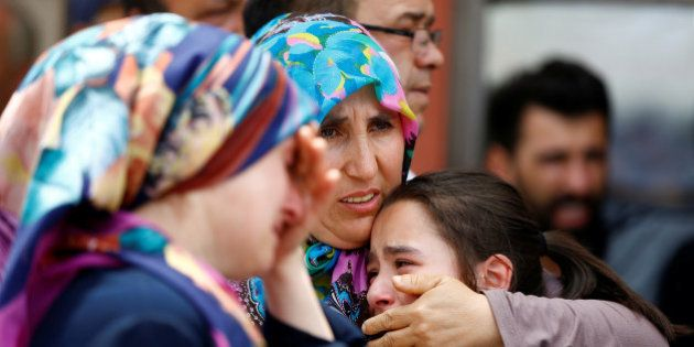 Relatives of one of the victims of yesterday's blast at Istanbul Ataturk Airport mourn in front of a...