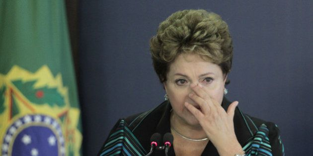 Brazil's President Dilma Rousseff cries during a speech at the launching ceremony of the National Truth...
