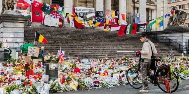 A man looks at a memorial site for the victims of the Brussels attacks at the Place de la Bourse in Brussels,...