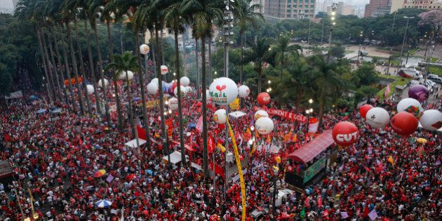 Demonstrators march in support of Brazil's President Dilma Rousseff and former President Luiz Inacio...