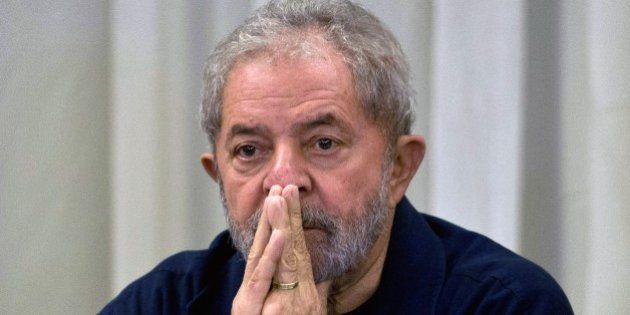 Former Brazilian President (2003-2011) Luiz Inacio Lula da Silva gestures during a meeting with the Workers'...