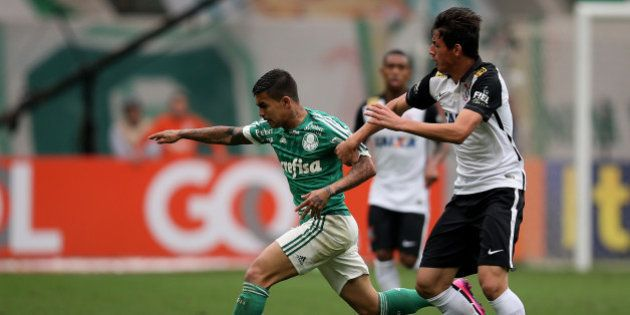 SAO PAULO, BRAZIL - SEPTEMBER 06: Dudu of Palmeiras fights for the ball with Marciel of Corinthians during...