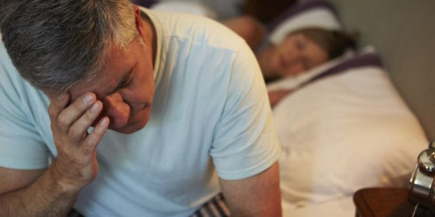 Man Awake In Bed Suffering With Insomnia Late At