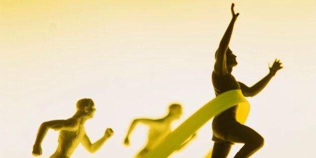 Figurines of men running reaching finish line