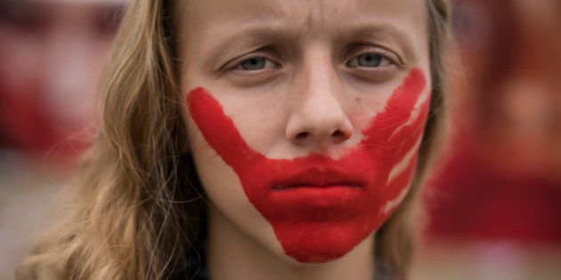 An activist poses for a photo during a protest against rape and violence against women on Copacabana...