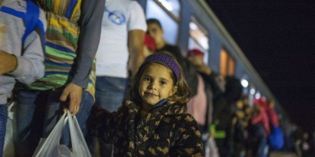 Migrants and refugees board a train, after crossing the Greek-Macedonian border, near Gevgelija on October...