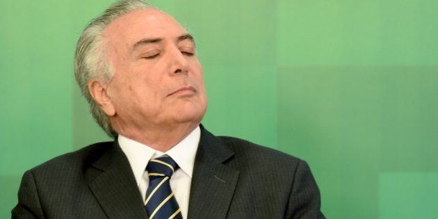 Brazil's acting President Michel Temer attends the ceremony to announce the increase of the Bolsa Familia...