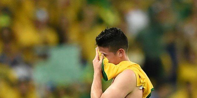 Colombia's midfielder James Rodriguez reacts as he leaves the pitch after the quarter-final football...