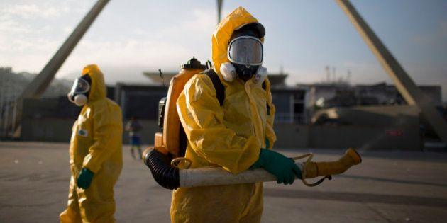 FILE - In this Tuesday, Jan. 26, 2016 file photo, a health workers stands in the Sambadrome spraying...