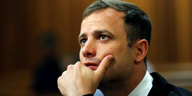 Olympic and Paralympic track star Oscar Pistorius looks on ahead of his manslaughter sentencing hearing...