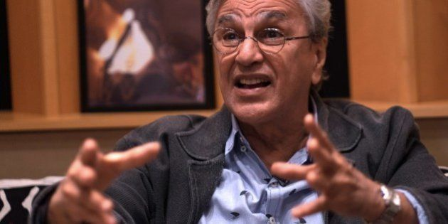 Brazilian musician Caetano Veloso gestures as he speaks with AFP during an interview with Brazilian colleague...