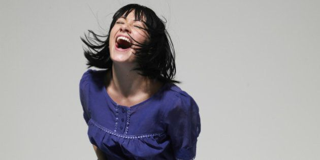 Young woman laughing, eyes
