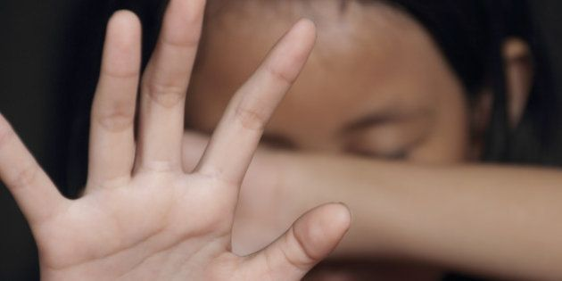 Little girl suffering bullying raises her palm asking to stop the