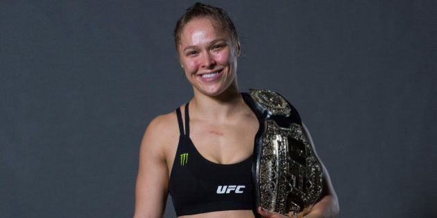 RIO DE JANEIRO, BRAZIL - AUGUST 01: UFC strawweight champion Ronda Rousey poses for a post fight portrait...