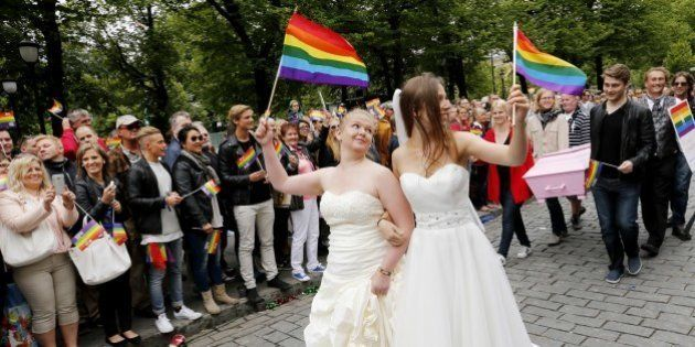 Participants of the lesbian, gay, bisexual and transgender (LGBT) 'Euro Pride' parade march through the...