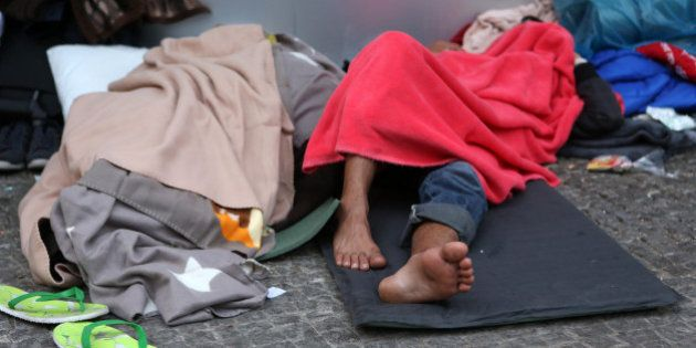 BERLIN, GERMANY - SEPTEMBER 26: Pakistani refugee Zahib Butt sleeps outside the LaGeSo State Office for...