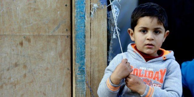 LEBANON, BEIRUT - DECEMBER 31: A Syrian child one of those who have been forced to leave their homes...